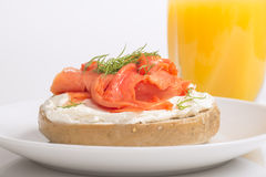 Freshly baked bagel with cream cheese, lox and orange juice Royalty Free Stock Photo