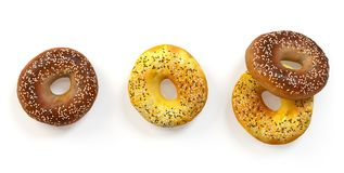 Freshly baked bagels with sesame. And flax seeds set isolated on white, top view. 3D illustration Stock Photos