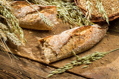 Freshly baked baguette broken in half Royalty Free Stock Photography