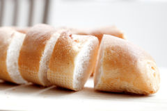 Freshly baked baguette sliced Stock Photo