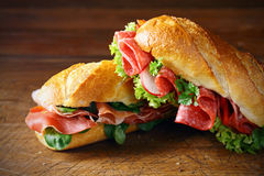 Freshly baked baguettes with ham and salami Royalty Free Stock Images