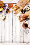 Freshly baked baguettes red wine and spicy sausage Royalty Free Stock Photography