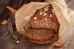 Freshly baked banana bread with almond in baking paper Stock Photo