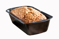 Freshly baked banana bread in tin loaf pan Royalty Free Stock Photos