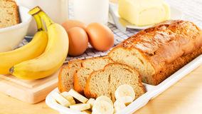 Freshly baked banana bread and ingredients Stock Image