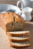 Freshly baked banana bread on wooden board Royalty Free Stock Photo