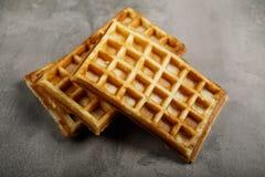 Freshly baked belgium waffles on concrete background Royalty Free Stock Image