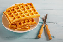 Freshly baked belgium waffles in plate. Breakfast concept Royalty Free Stock Image