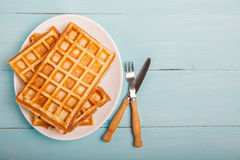 Freshly baked belgium waffles in plate. Breakfast concept with c Stock Photos