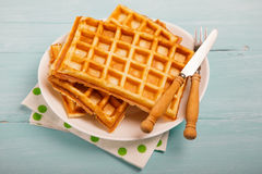 Freshly baked belgium waffles in plate. Breakfast concept with c Royalty Free Stock Photos
