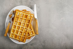 Freshly baked belgium waffles in plate with copy space. From top view Royalty Free Stock Images