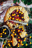 Freshly baked berry pie. Blackberries pie with a slice missing. Royalty Free Stock Photos