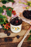 Freshly baked berry pie. Blackberries pie with a slice missing. Stock Images