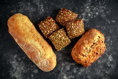 Freshly baked bloomer, ciabatta bread and sandwich buns.  Royalty Free Stock Images