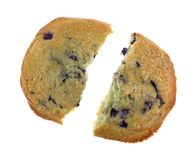 Freshly baked blueberry muffin top broken in half Stock Image