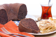 Freshly baked borek and chocolate cake at a party Royalty Free Stock Photos