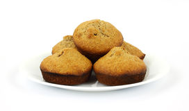Freshly baked bran muffins on white plate Royalty Free Stock Photo