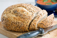 Freshly baked bread. Cut into slices with a knife Royalty Free Stock Photos