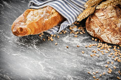 Freshly baked bread and baguette in rustic setting Royalty Free Stock Photo
