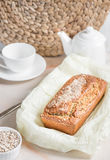 Freshly baked bread with bran from oat flour with sesame, bran a. Freshly baked bread with bran from oat flour with sesame seeds and flax seeds, on paper for Stock Image