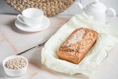 Freshly baked bread with bran from oat flour with sesame, bran a. Freshly baked bread with bran from oat flour with sesame seeds and flax seeds, on paper for Royalty Free Stock Image