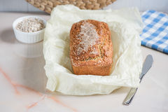 Freshly baked bread with bran from oat flour with sesame, bran a. Freshly baked bread with bran from oat flour with sesame seeds and flax seeds, on paper for Stock Photo