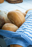 Freshly baked bread buns and tablecloth Royalty Free Stock Photos