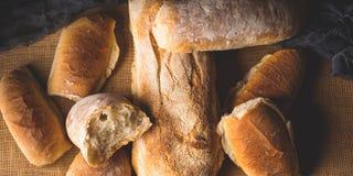 Freshly baked bread on burlap dark wooden background Stock Photography