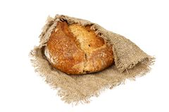 Freshly baked bread on cloth isolated on white background.  Stock Photography