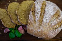 Freshly baked bread on dark gray kitchen table, top view stock photo