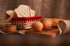 Freshly baked bread on dark wooden kitchen table. Selective focus. Freshly baked bread on dark wooden kitchen table royalty free stock photography