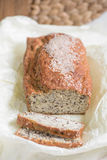 Freshly baked bread from oat flour with sesame, bran and flax se. Freshly baked bread with bran from oat flour with sesame seeds and flax seeds, on paper for Royalty Free Stock Photography