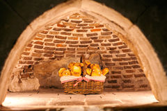 Freshly baked bread in an old stone oven Royalty Free Stock Photography