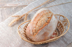 Freshly baked bread on a old wooden and linen background. Closeu Stock Photos