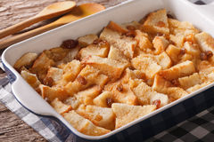 Freshly baked bread pudding with raisins close up in baking dish Royalty Free Stock Photos