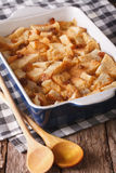 Freshly baked bread pudding with raisins close up in baking dish Stock Photos