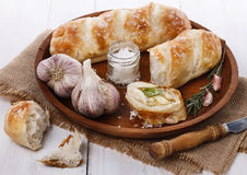 Freshly baked bread rolls and garlic Stock Images
