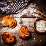 Freshly baked bread rolls on old wooden table. Royalty Free Stock Photo