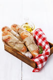 Freshly baked bread rolls over white wooden background Royalty Free Stock Image