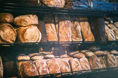 Freshly baked bread in rustic bakery stock photography