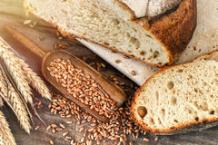 Freshly baked bread in rustic setting Stock Images