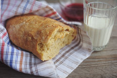 Freshly baked bread served with jam and glass of milk. Royalty Free Stock Photography