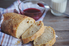 Freshly baked bread served with jam and glass of milk. Stock Image