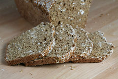 Freshly baked bread, sliced. Freshly baked bread, with four slices.  Rye and wheat with sesame seeds on top Royalty Free Stock Images