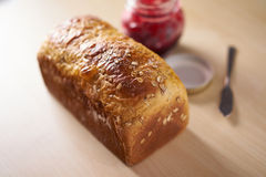 Freshly baked bread with strawberry jam Royalty Free Stock Images