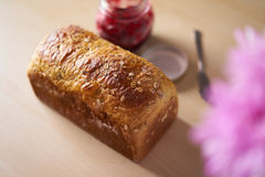 Freshly baked bread with strawberry jam Stock Images