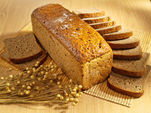 Freshly baked bread on table. Fresh brown bread on table stock photos