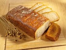 Freshly baked bread on table. Fresh brown bread on table stock image