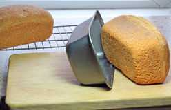 Freshly baked bread turned out of tin. Stock Photography
