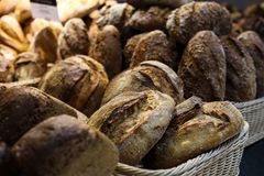 Freshly baked bread in the white basket royalty free stock images